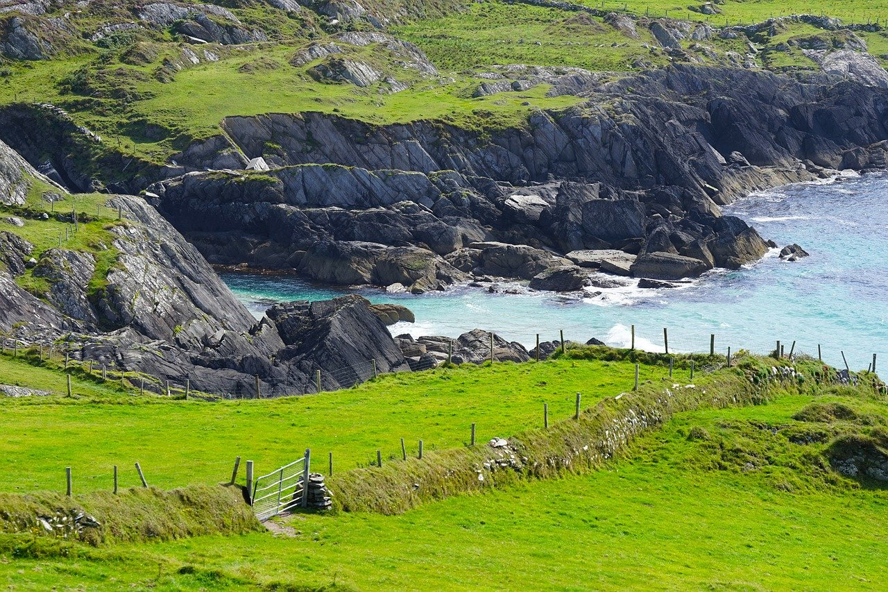 Ireland coastline with rolling green hills and cliffs