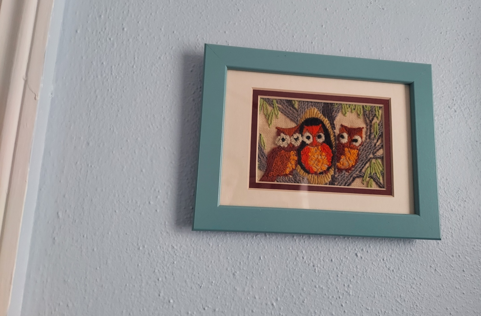 framed embroidery of 3 owls