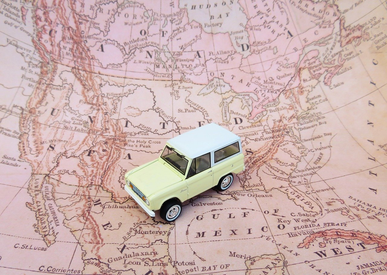 toy SUV wandering map of North America