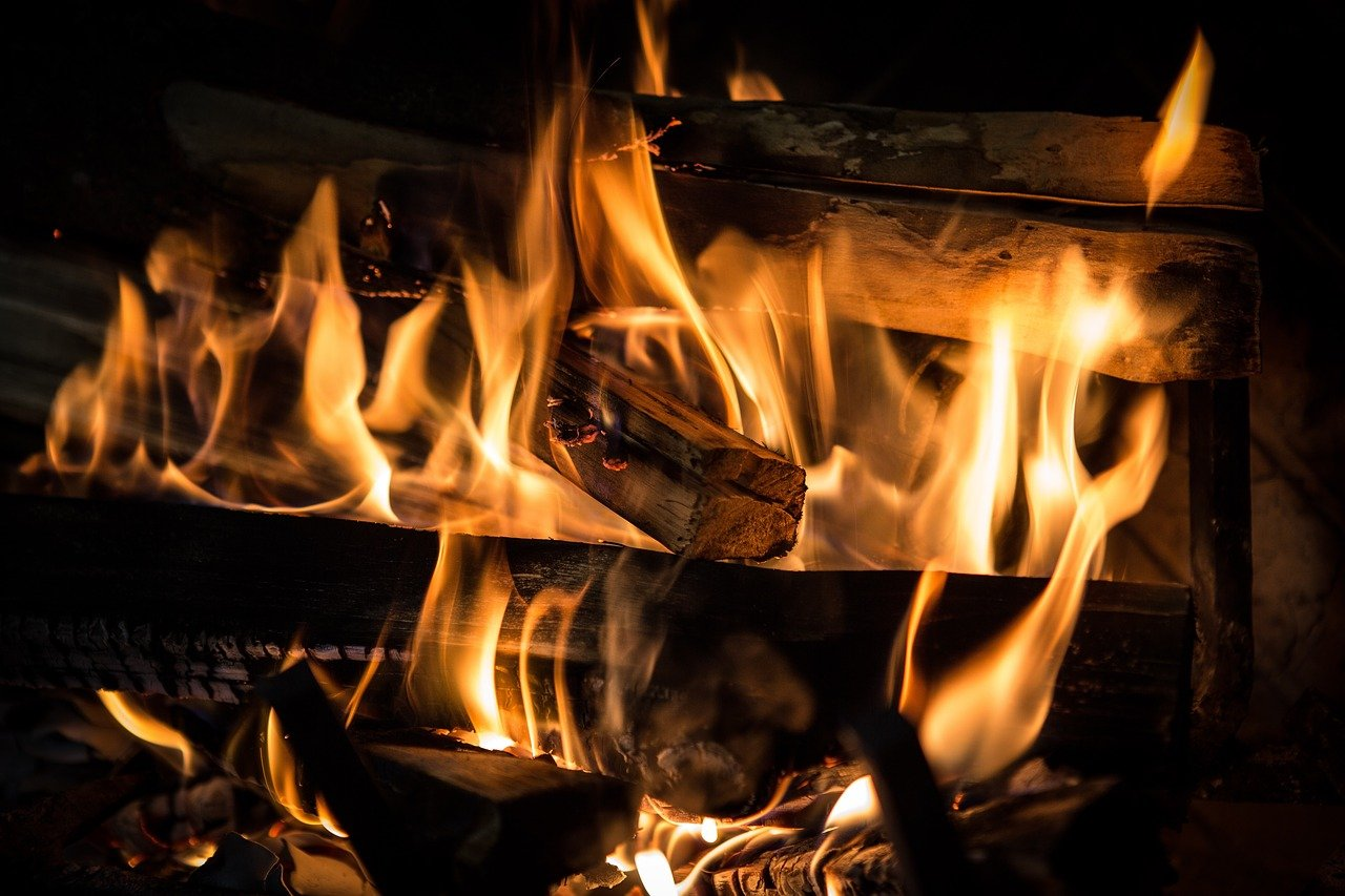 flames in woodburning fireplace