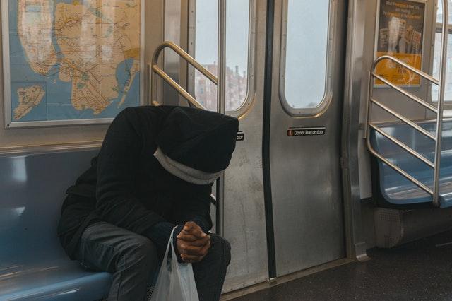 man alone on subway train