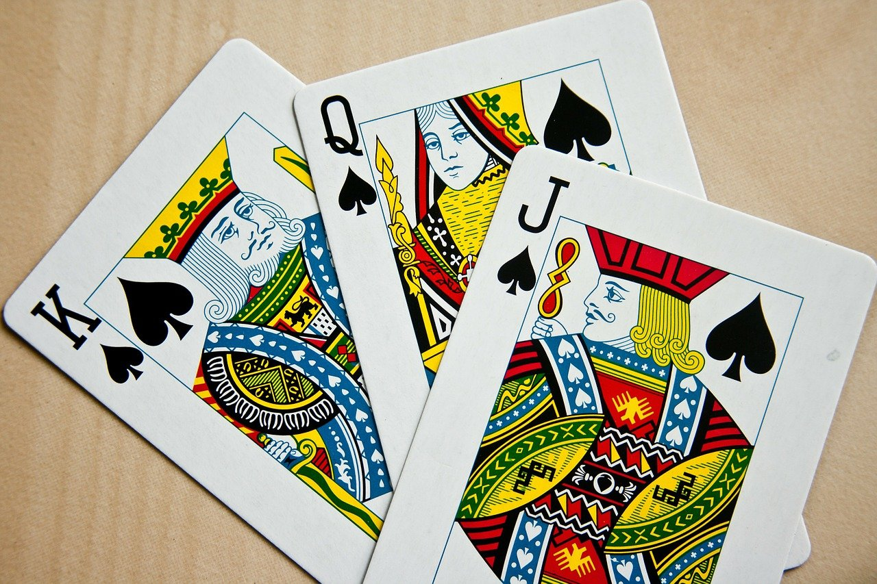 Playing cards: King, Queen, and Jack